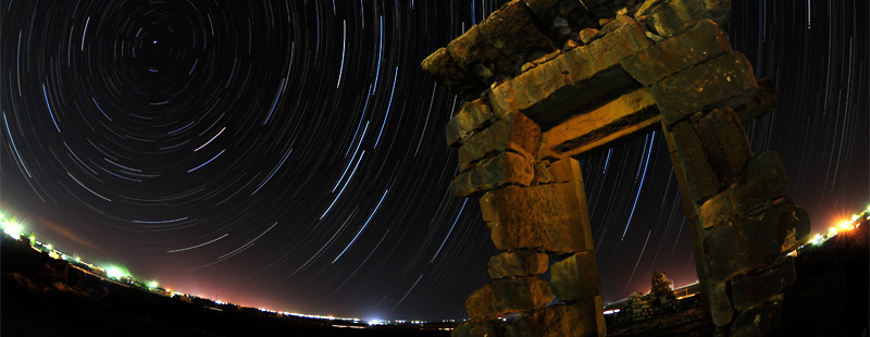 Main image: Star trails arc through the night sky over a ruined second story doorway in Byzantine-Islamic Umm el-Jimal's northern neighborhood.