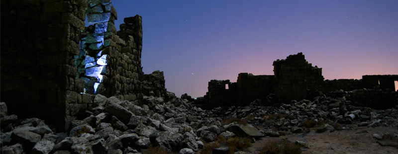 Main image: Moonlight shines on rubble under a winter night sky in the remote northern section of Umm el-Jimal's ancient Byzantine and early Islamic town.